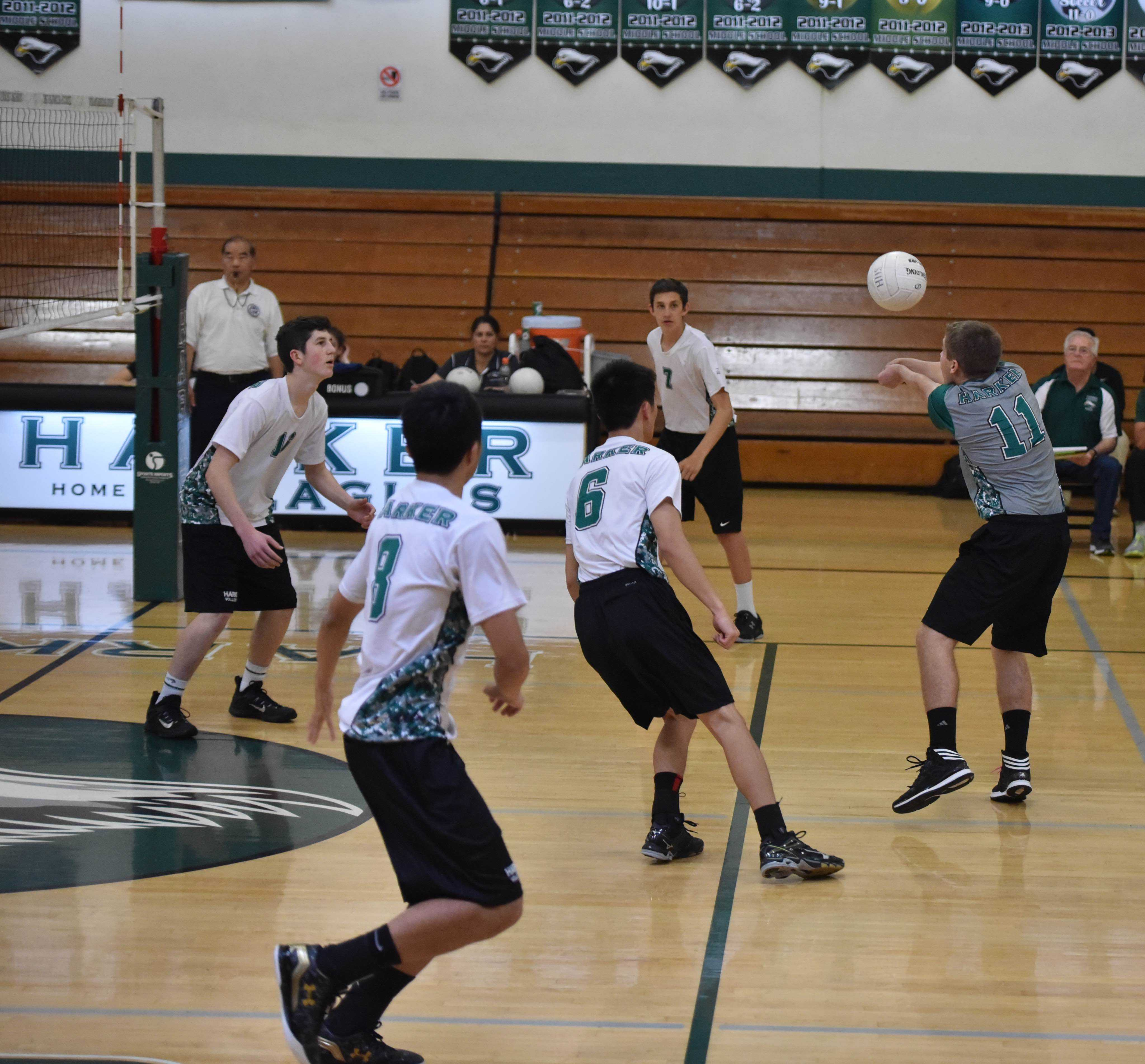 Libero Jonathan Schwartz (11) digs a hit from Wilcox while Andrew Gu (11), Ray Song (11) and Jarrett Anderson (9) get into hitting position.