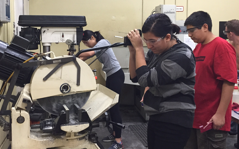 Sarah Gonzalez (11) participates in metal shop training. The Subatomic Smarticles will travel to St. Louis to participate in the World Championship from April 27-30.