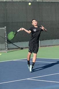Kai Franz (9) hits an overhead shot. The tennis team ended their season in the second round of CCS.