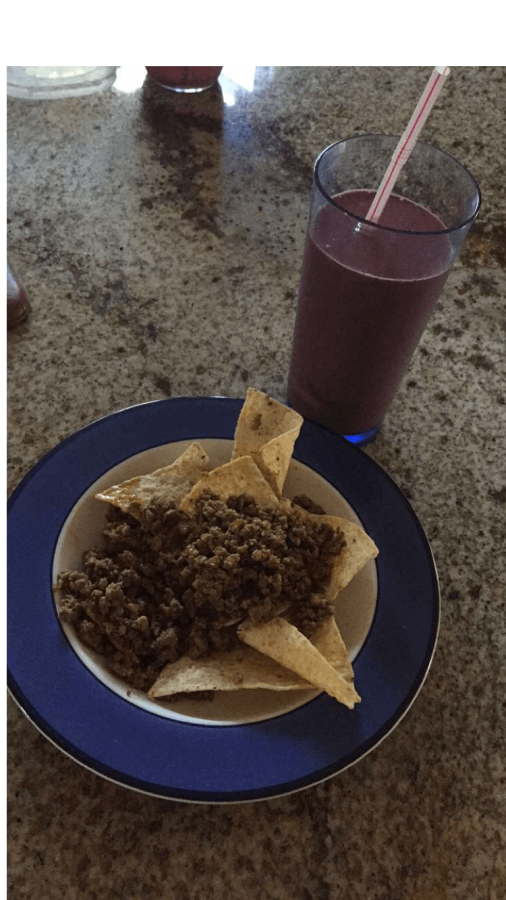 Kailee eats beef tacos with a kale infused smoothie.