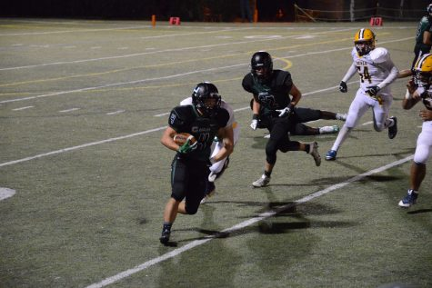 Varsity football team loses home opener to Menlo