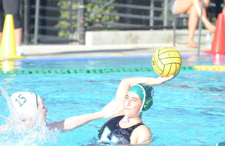 Nina+Levy+%2812%29+gets+ready+to+pass+the+ball+against+Homestead+last+year.+Varsity+girls+water+polo+lost+to+Homestead+3-2.