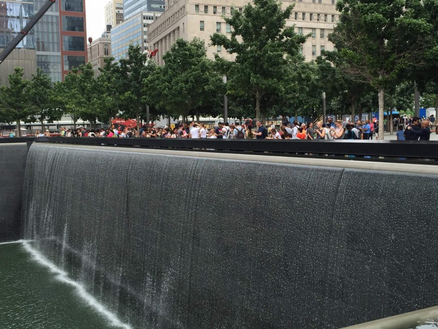 Hundreds of people line up  at the 9/11 Memorial in New York and pay homage to the people who died during the tragic 9/11 attacks. Members of the upper school community were among those with friends and family working in the World Trade Center on 9/11.