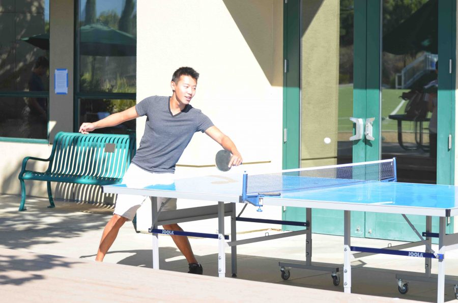 Senior Peter Wu plays pingpong outside Shah. Student council has privatized access to the pingpong tables, only allowing seniors the privilege to use it.
