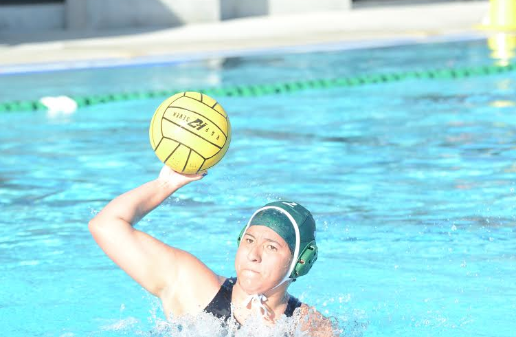 Sarah Gonzales (12) throws the water polo ball. The girls varsity water polo team is currently 3-9 in league and 5-12 overall.