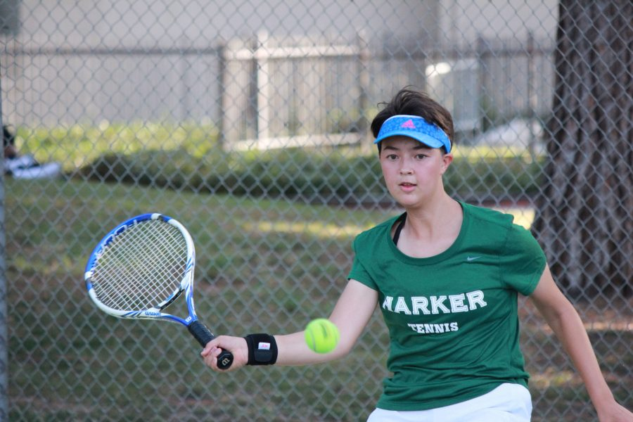 Gina Partridge (9) hits the tennis ball. The girls tennis team is currently 3-4 in league, 8-4 overall.