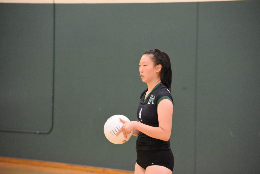 Rachel Cheng (12) prepares to serve the volleyball. The girls volleyball team is currently 2-4 in league and 4-12 overall.