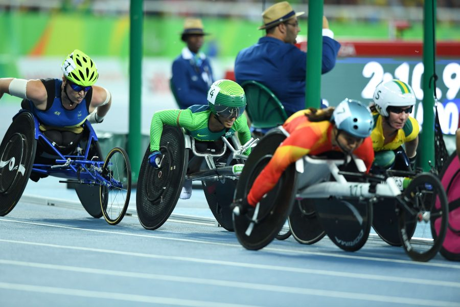Paralympic+athletes+race+against+one+another+in+the+women%27s+T54+1500-meter+race.+Athletes+are+eligible+in+T54+races+if+they+have+spinal+cord+injuries+and+use+only+their+upper-body+muscles+in+the+race.+%0A