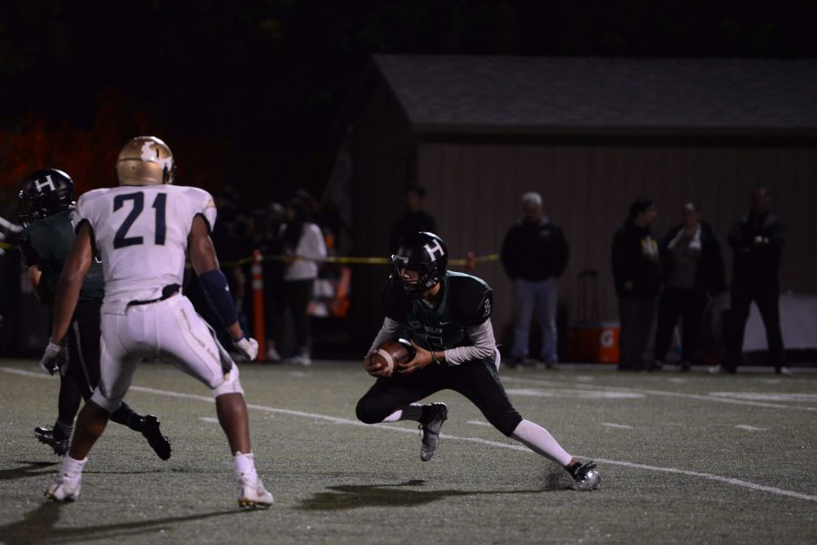 Quarterback Nate Kelley (11) darts past Stellar Prep's defense. The Eagles lost to the Thunder 7-42 during Homecoming on Nov. 5, which also doubled as this year's football senior night.