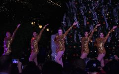 Varsity dance poses at the end of their routine. Varsity dance, JV dance, Kinetic Krew and Downbeat were among some of the groups that performed at the Santana Row Tree Lighting ceremony last year.