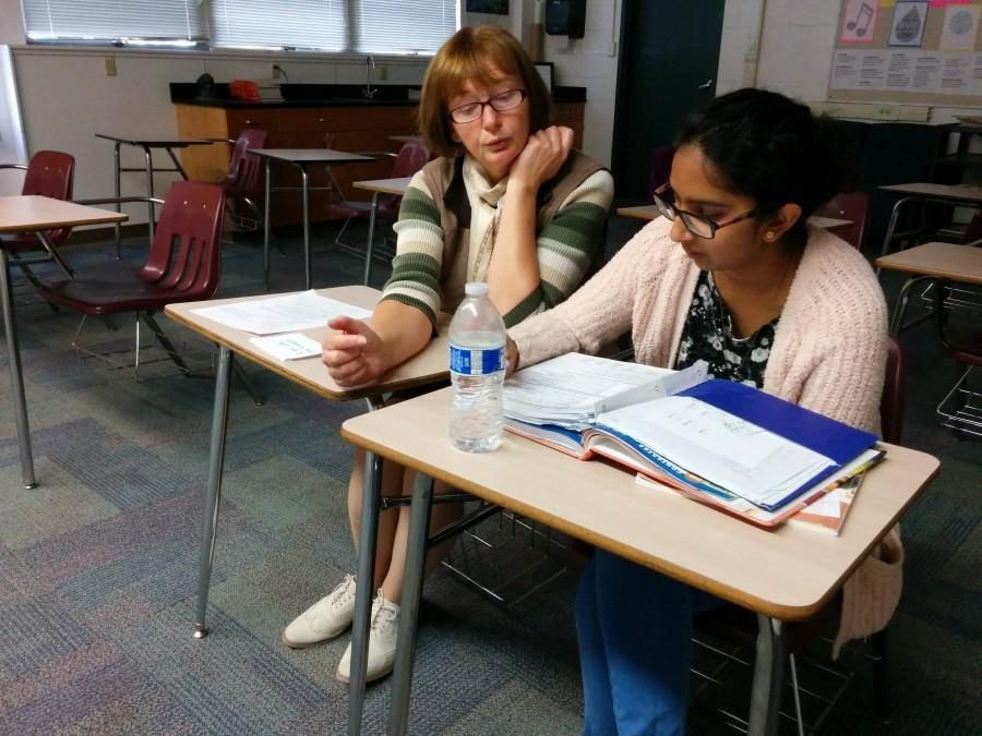 Student Jessica Susai (11) sits with her teacher Ms. Tchourilova. Upper school parent-teacher conferences will take place at the upper school next Monday and Tuesday.