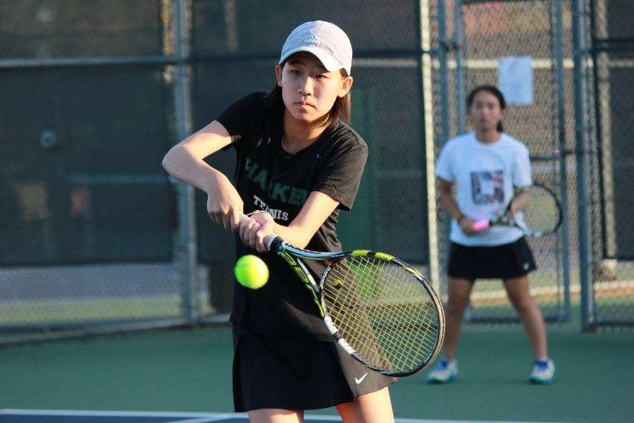Connie Miao (12) hits a backhand during practice. Connie was the only senior on the girls golf team this year.