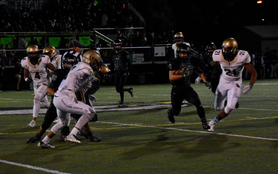 Runningback Will Park (12) runs the ball during a play. The eagles lost homecoming 7-42.