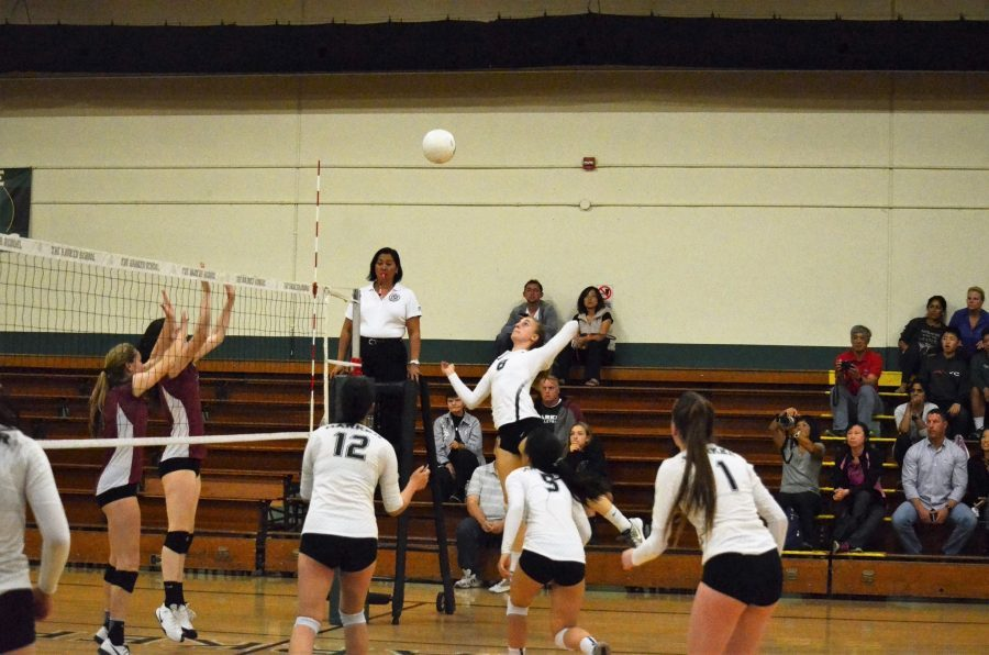 Isabella Spradlin(11) jumps to hit in a match against Sacred Heart Prep. The girls volleyball team ended the season with a 3-6 league record and a 6-18 overall record.