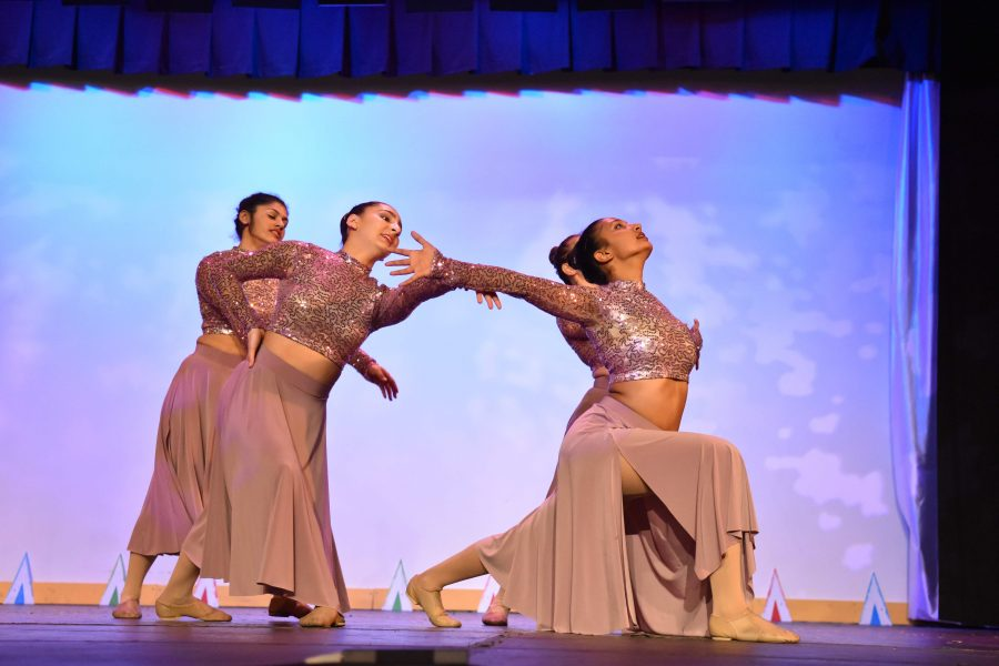 Seniors Noor Singh, Hazal Gurcan, Surabhi Rao and Tamlyn Doll dance to the song Glitter in the Air by P!nk. This routine featured the four senior members of the varsity dance team.