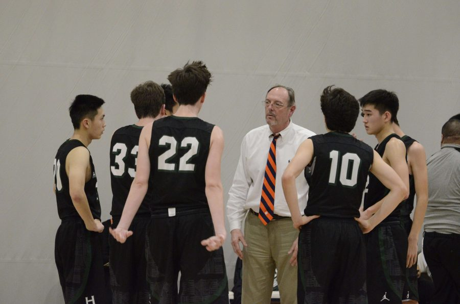 Varsity+basketball+head+coach+Samuel+%22Butch%22+Keller+talks+to+his+players.+Keller+reached+his+600th+career+win+on+Tuesday.