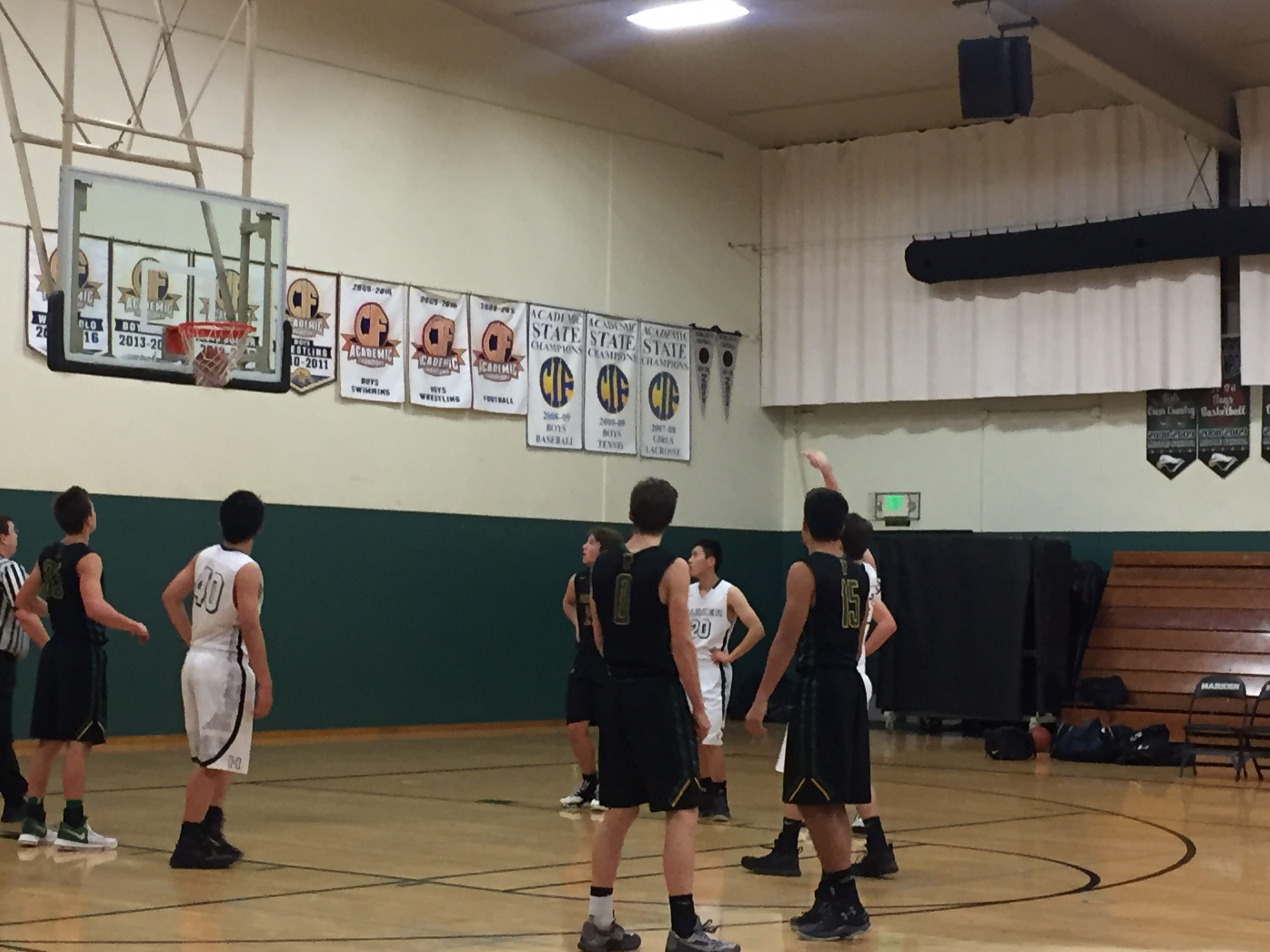 A Harker player makes a free throw during the first quarter of the game. The score at the end of the game was 38-66.