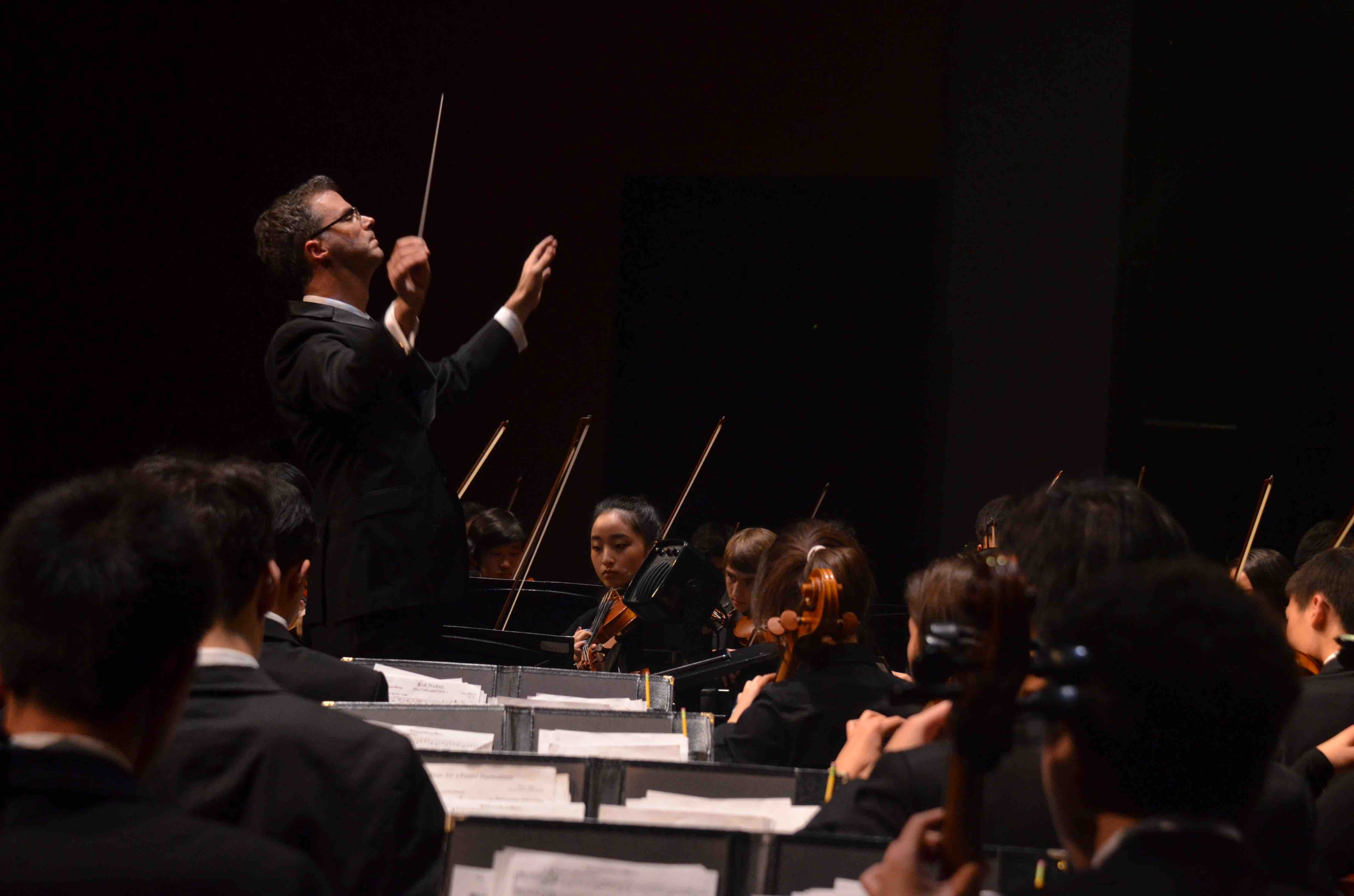 Orchestra+teacher+Chris+Florio+conducts+the+ensemble+during+the+show.+The+Winter+Concert+took+place+on+January+13+at+the+Mexican+Heritage+Theater.