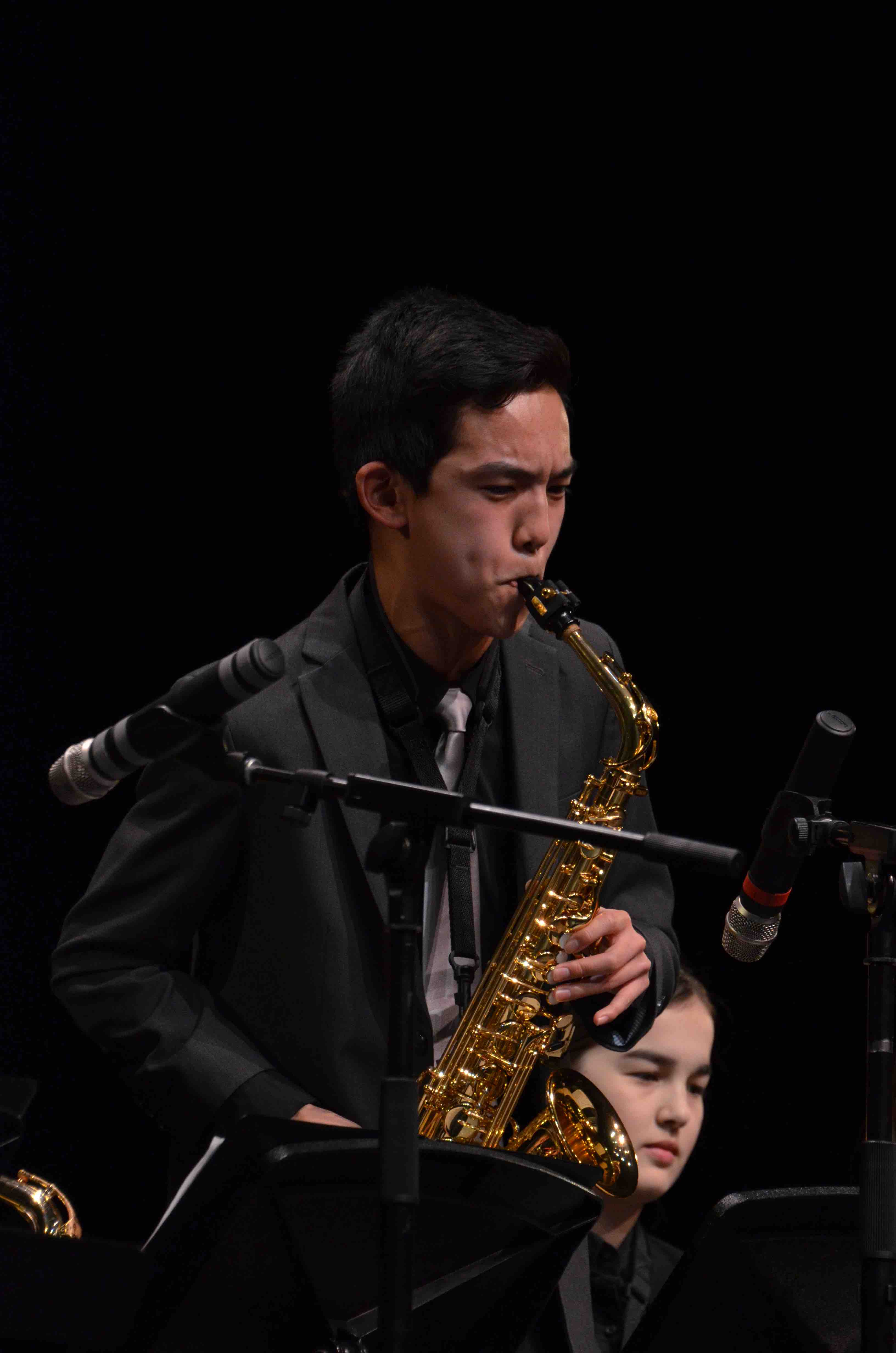Bryan+Wang+%289%29+plays+saxophone+with+the+upper+school+Jazz+Band.+The+Winter+Concert+took+place+on+January+13+at+the+Mexican+Heritage+Theater.