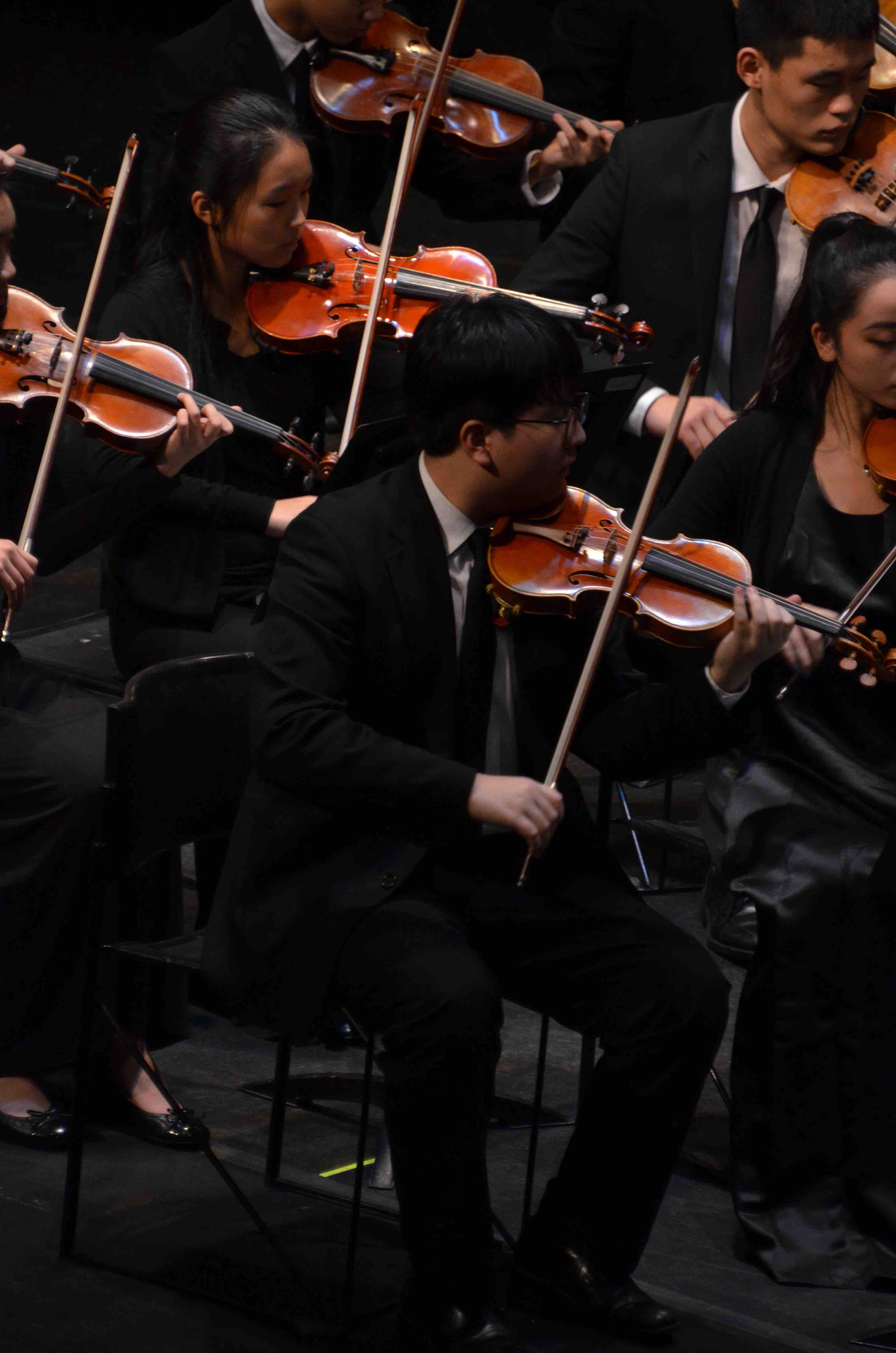 Cuebeom+Choi+%2812%29+plays+violin+as+a+part+of+the+upper+school+Orchestra.+The+Winter+Concert+took+place+on+January+13+at+the+Mexican+Heritage+Theater.