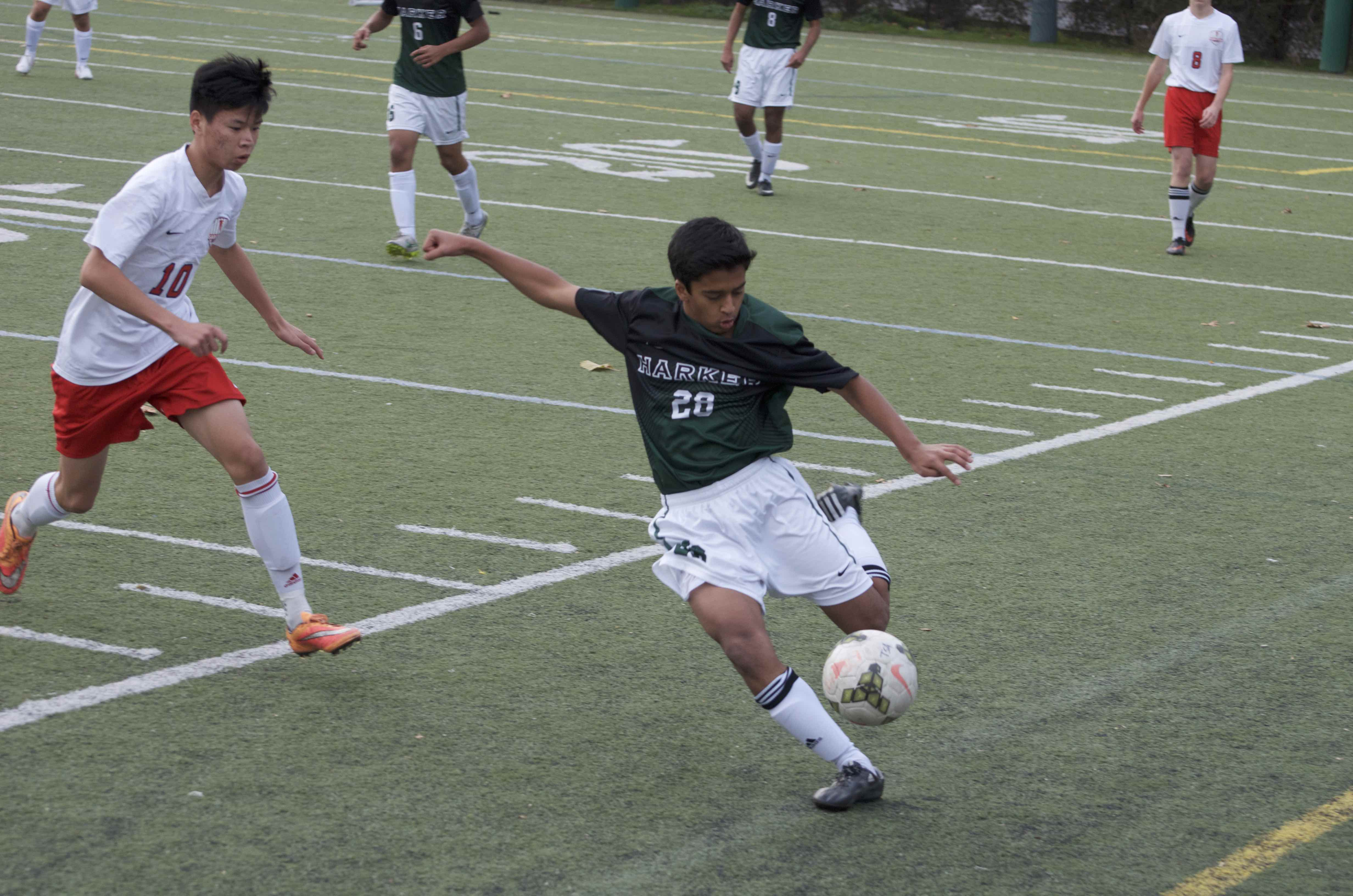 Rohit Shah (11) kicks far past the goal line. This is his second year on the Varsity Boys Soccer team.