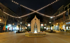 A shot of Santana Row's main street and plaza, highlighting its walkable spaces and open storefronts and restaurants. Santana Row's design was inspired by the street La Rambla in Barcelona, Spain, a shopping area dominated by pedestrians.