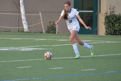 Joelle Anderson (12) prepares to kick the soccer ball. She ended her high school career with 101 goals.