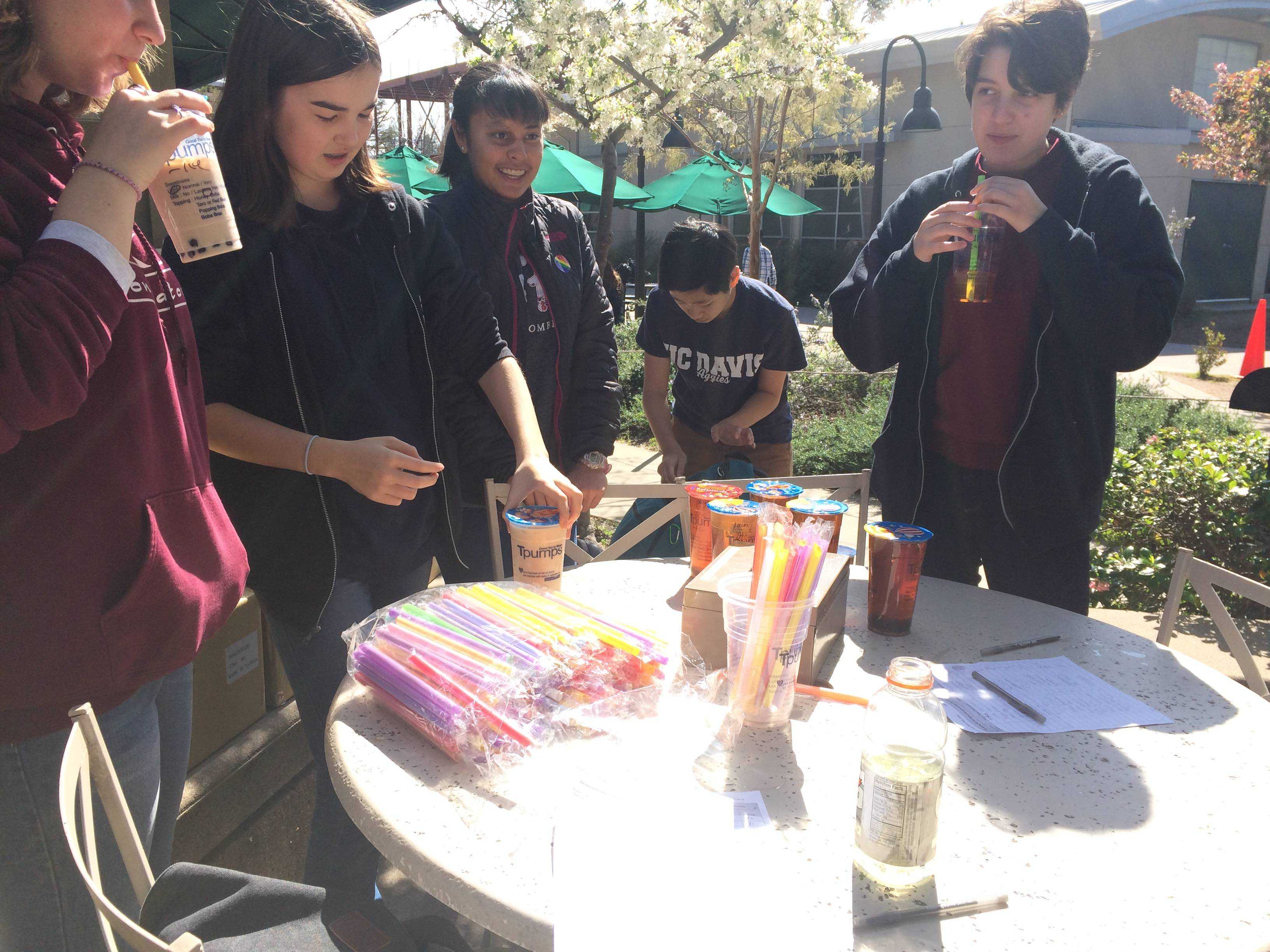 GSA club members Emmy Huchley (10), Sian Smith (10), Damini Kaushik (10), Kevin Huang (12) and Emilie Sanche (10) sell boba outside of Manzanita. GSA members also handed out rainbow smiley stickers to students and faculty on Monday during lunch.