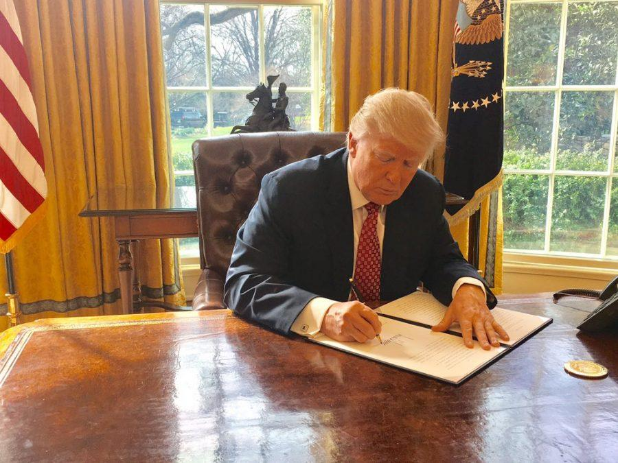 Trump signs an executive order. He has continued to sign and update executive orders since their initial implementations.