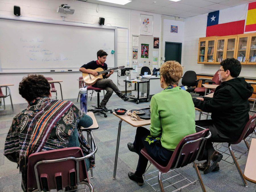 Joshua Valluru (9) performs a guitar piece to judges and Spanish teachers Isabel Garcia, Diana Moss and Abel Olivas. Auditions for La Noche Cultural were held last Thursday during long lunch in Mr. Olivas room.