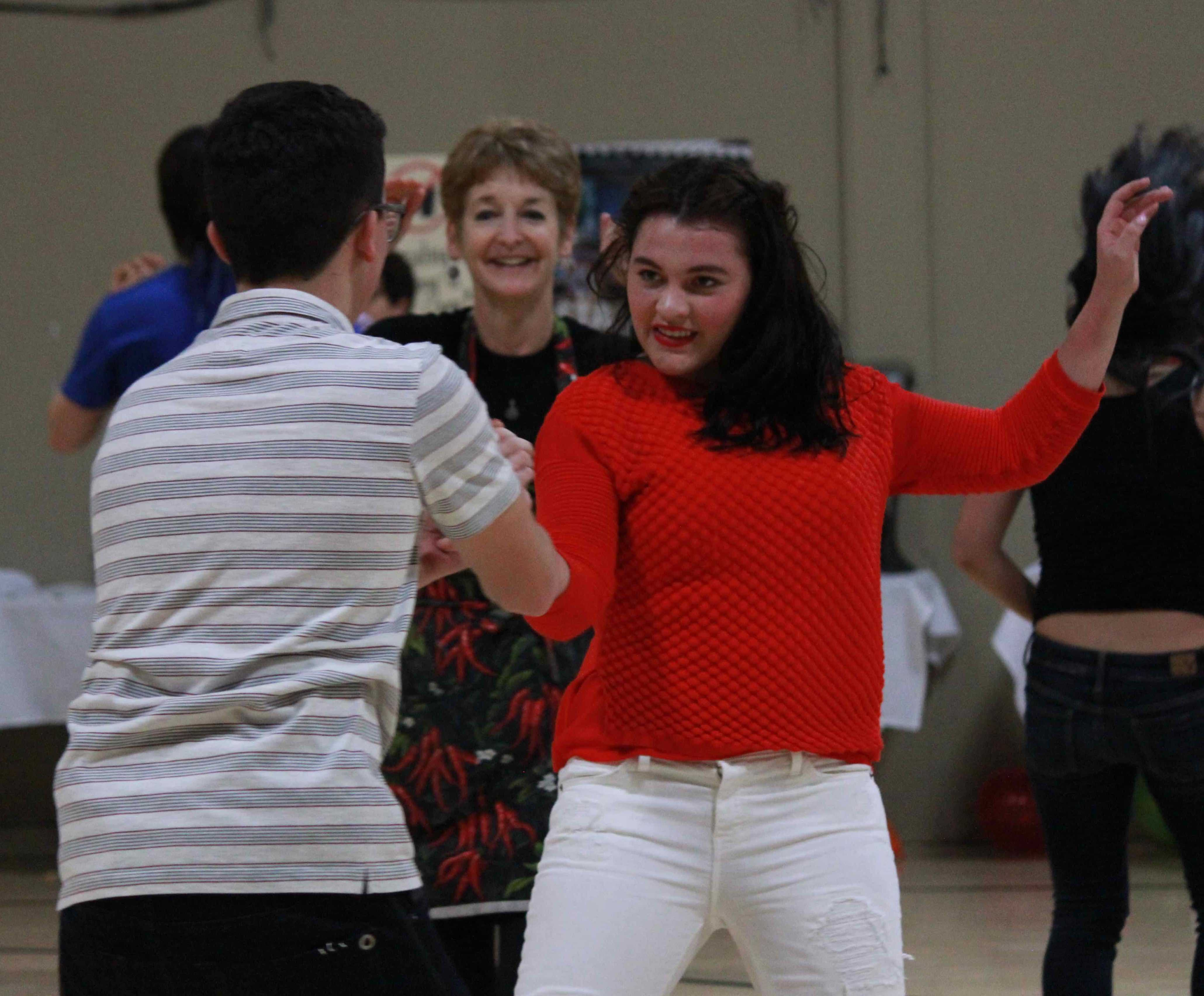Devin Keller (9) and Haley Keller (11) show off their dance moves during the salsa dancing competition held at La Noche Cultural. Both also performed in a dance routine in the talent show prior to the salsa dancing competition.