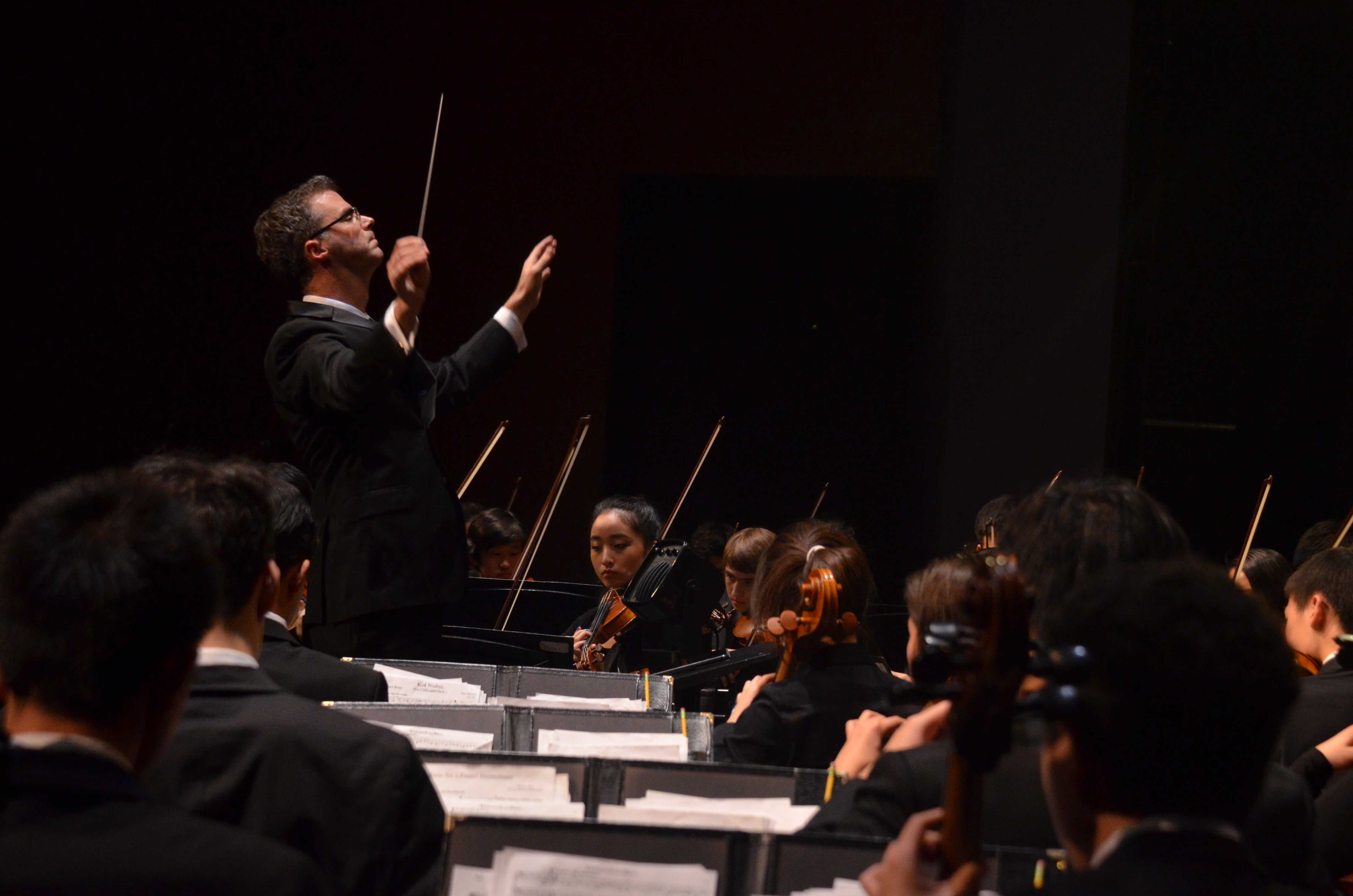 Orchestra conductor Chris Florio conducts the orchestra during the annual Winter Concert. The orchestra is currently in New York for their performance at Carnegie Hall.