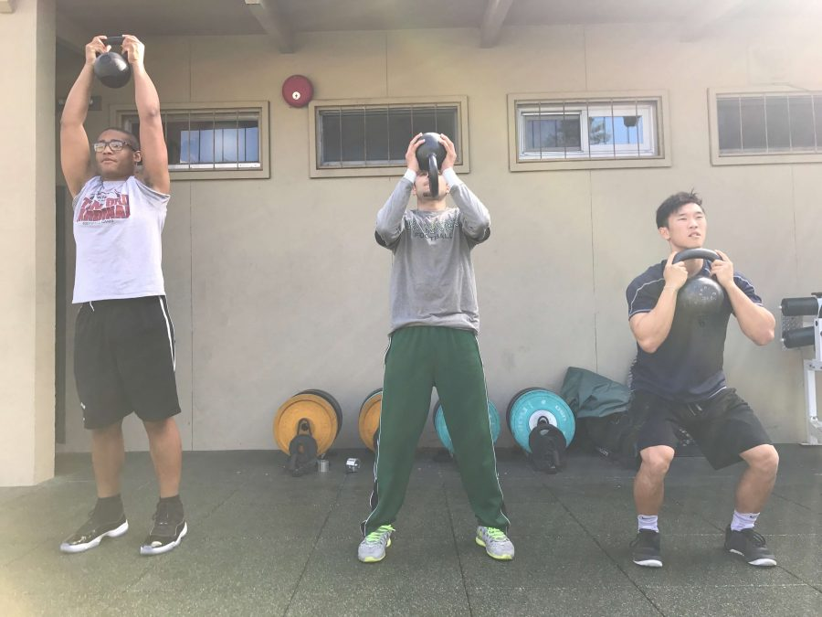 Jadan McDermott (11), Norman Garcia (12), and Will Park (12) work out at the weight room. Conditioning is a vital part of an athlete's training.