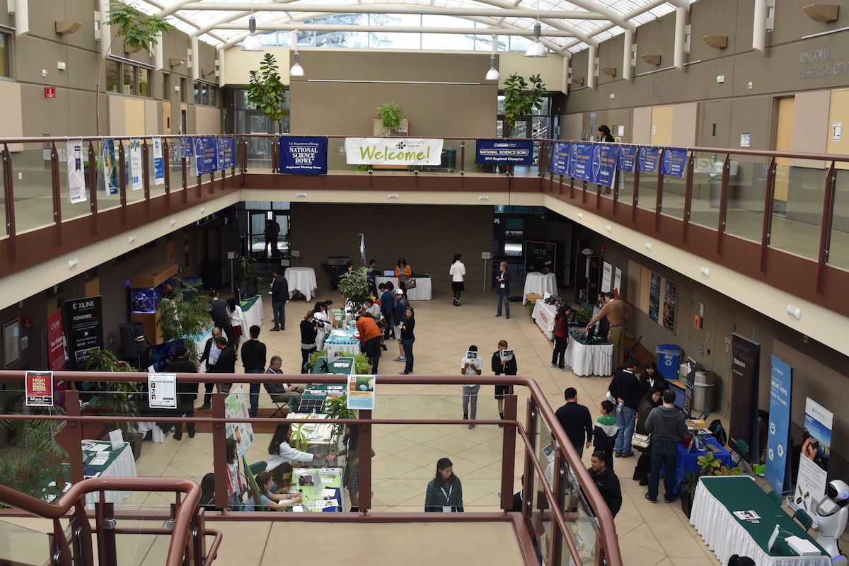 Attendees visit corporate booths in the Nichols Atrium. The annual Harker Research Symposium was held on Saturday.