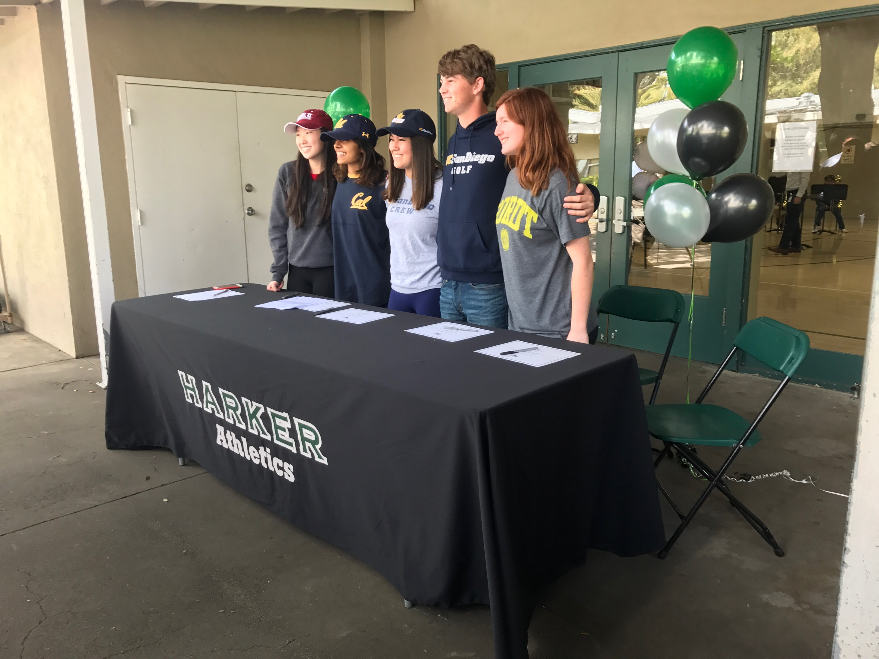 Seniors Rachel Cheng, Niki Iyer, Taylor Iantosca, Ryan Vaughan, and Marti Sutton pose for a photo. These five seniors signed for their respective college athletics programs today.
