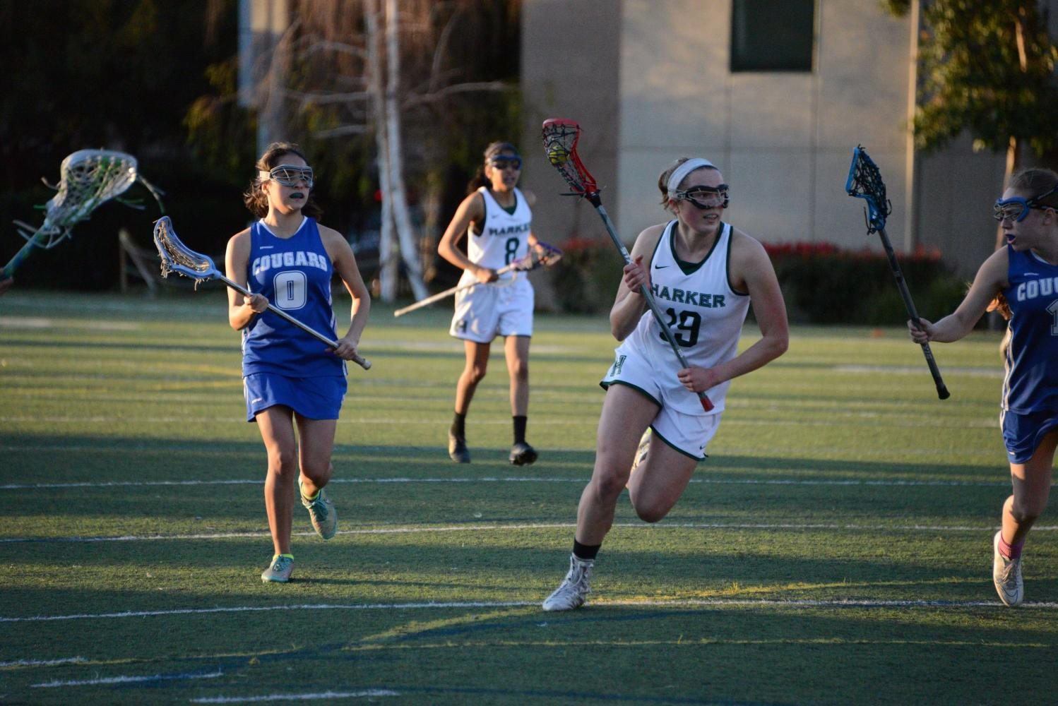 Alayna Richmond runs with the lacrosse ball. The lacrosse team currently holds a league record of 1-3.