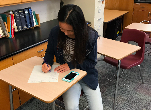 Alyssa Huang (9) signs in to vote for this year's JCL elections. In an email announcement, JCL advisor Scott Paterson named Andy Semenza (11) president, Edgar Lin (11) vice president, Jeffrey Fung (9) secretary, Timmy Chang (10) historian and Nikhil Dharmaraj (10) webmaster.