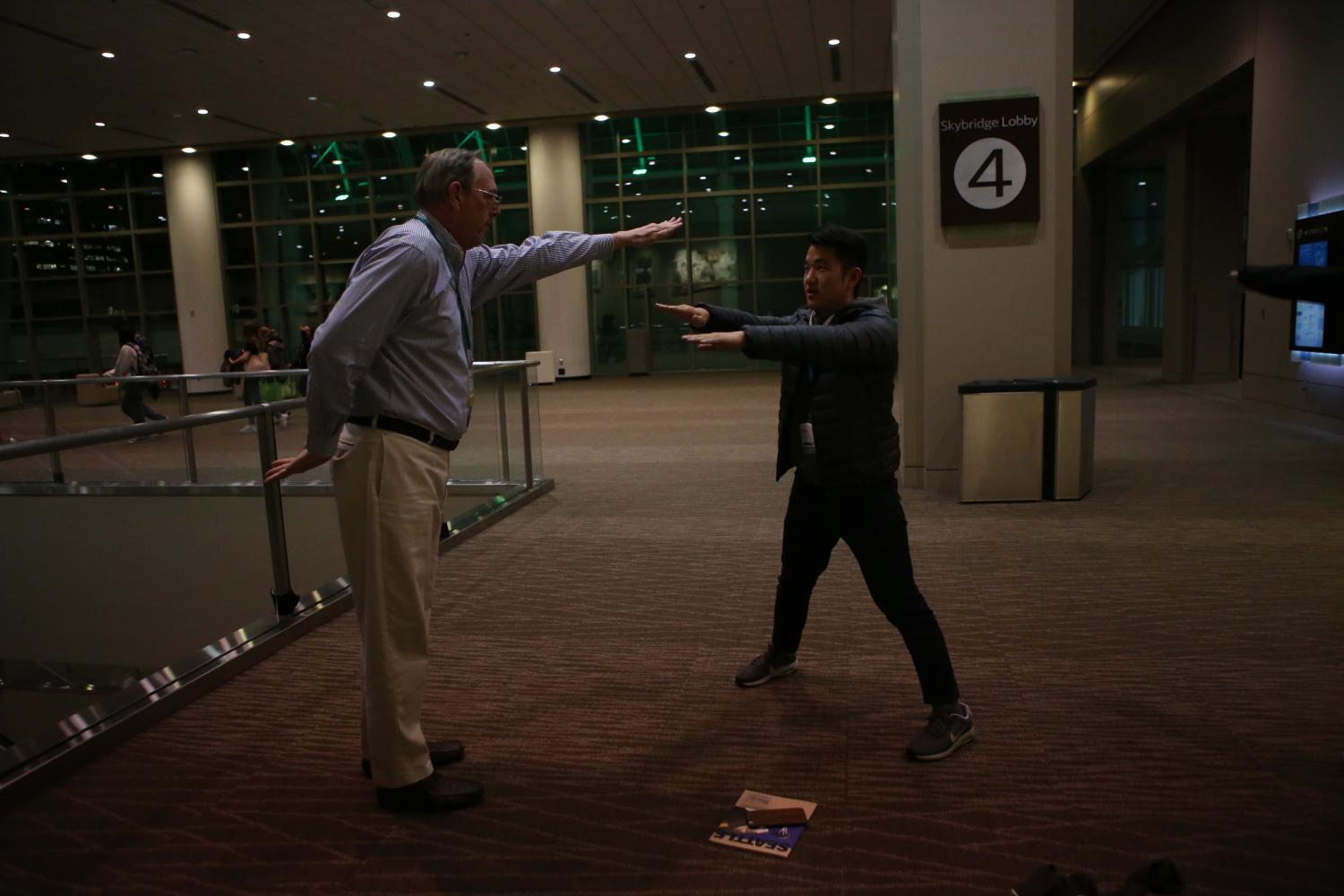 Butch Keller and Alex Youn whip at the Seattle presentation last week. The journalism program sent a group of programs to Seattle last month.