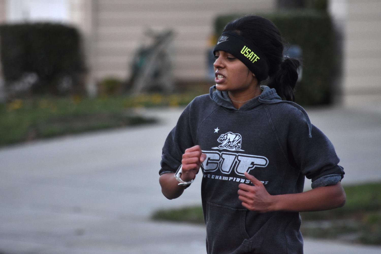 Niki runs in her Cupertino neighborhood on Dec. 17.