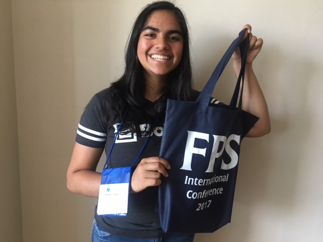FPS+International+Conference+attendee+Anika+Banga+%2811%29+poses+with+some+FPS+merchandise+from+the+International+Conference+student+store.+Anika+and+Saloni+Shah+%288%29+were+the+two+students+representing+Harker+at+this+year%27s+International+Conference+in+Wisconsin.