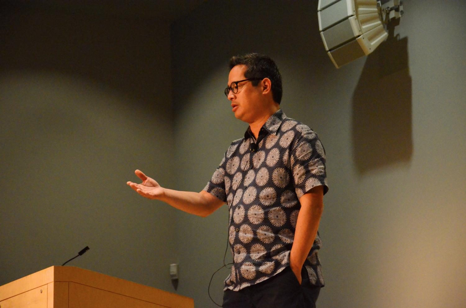 """Speaker Jeff Chang gestures as he talks about his journey towards becoming a writer on cultural issues. Chang was named a USA Ford Fellow in Literature in 2008 by philanthropic arts organization United States Artists and one of """"50 Visionaries Who Are Changing Your World"""" by American magazine Utne Reader in 2009."""