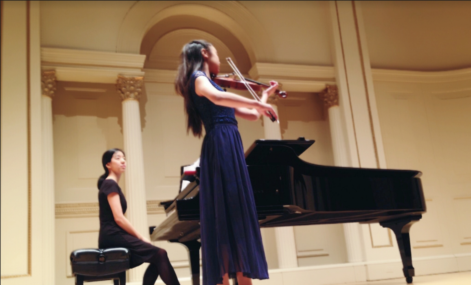 Constance Horng (11) performs at Weill Hall at Carnegie Hall last year. Constance has been experimenting with music since she was five.