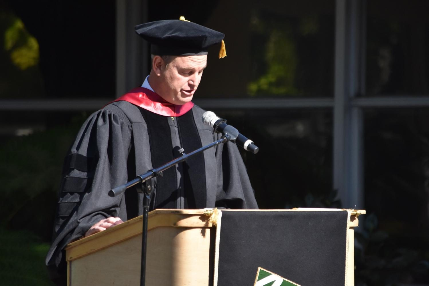 Head+of+School+Brian+Yager+delivers+his+opening+comments+at+this+years+Matriculation.+Before+his+remarks%2C+the+upper+school+faculty+and+the+Class+of+2021+participated+in+processionals+into+the+quad.
