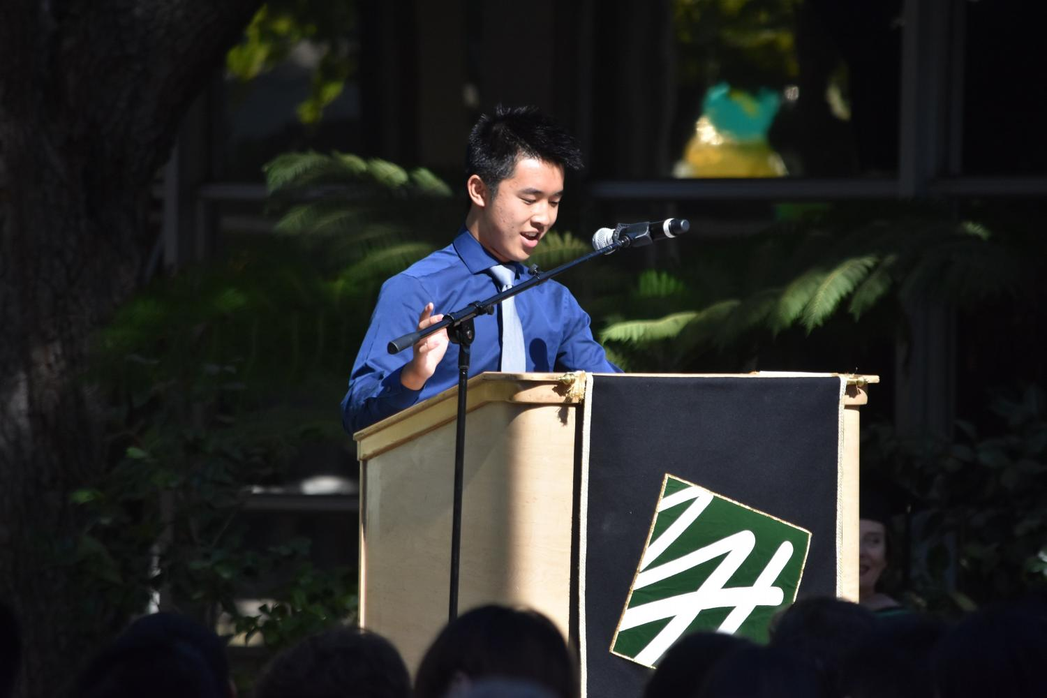 ASB President Jimmy Lin (12) addresses the Matriculation audience. After sharing an anecdote about his learning to ride a bicycle in high school, he introduced the student council and honor council representatives of each class for this school year.