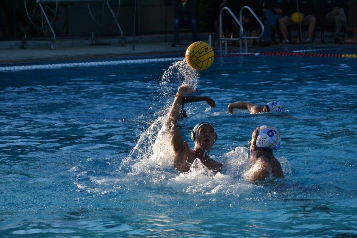 Senior+Edgar+Lin+catches+the+ball+while+avoiding+a+Monta+Vista+player.+The+varsity+boys%E2%80%99+water+polo+team+won+14-6.+