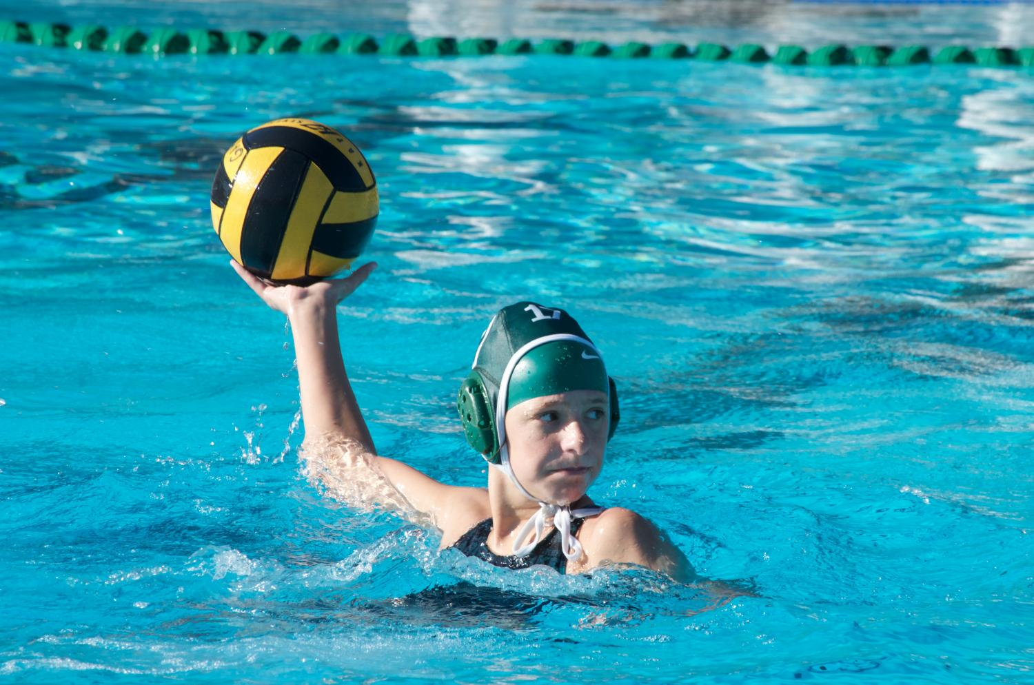 Sophie Durn (9) throws the ball to a teammate during the home game against Milpitas High School. Sophie is one of four freshmen on the varsity girls water polo team.