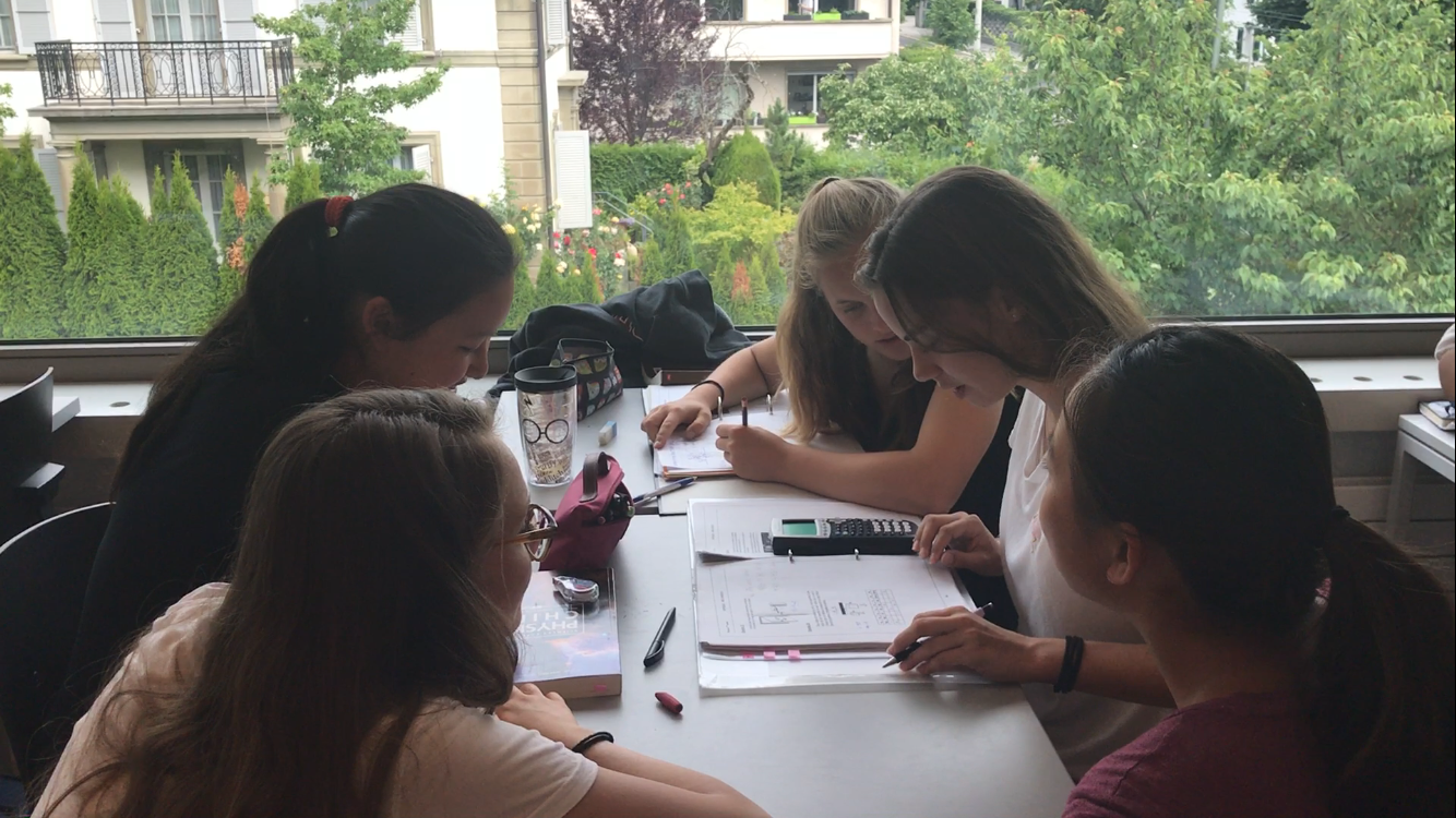 Harker Swiss trip attendees watch as their buddies complete their assigned math homework. A total of 12 upper school students traveled to Switzerland for nine days in June.