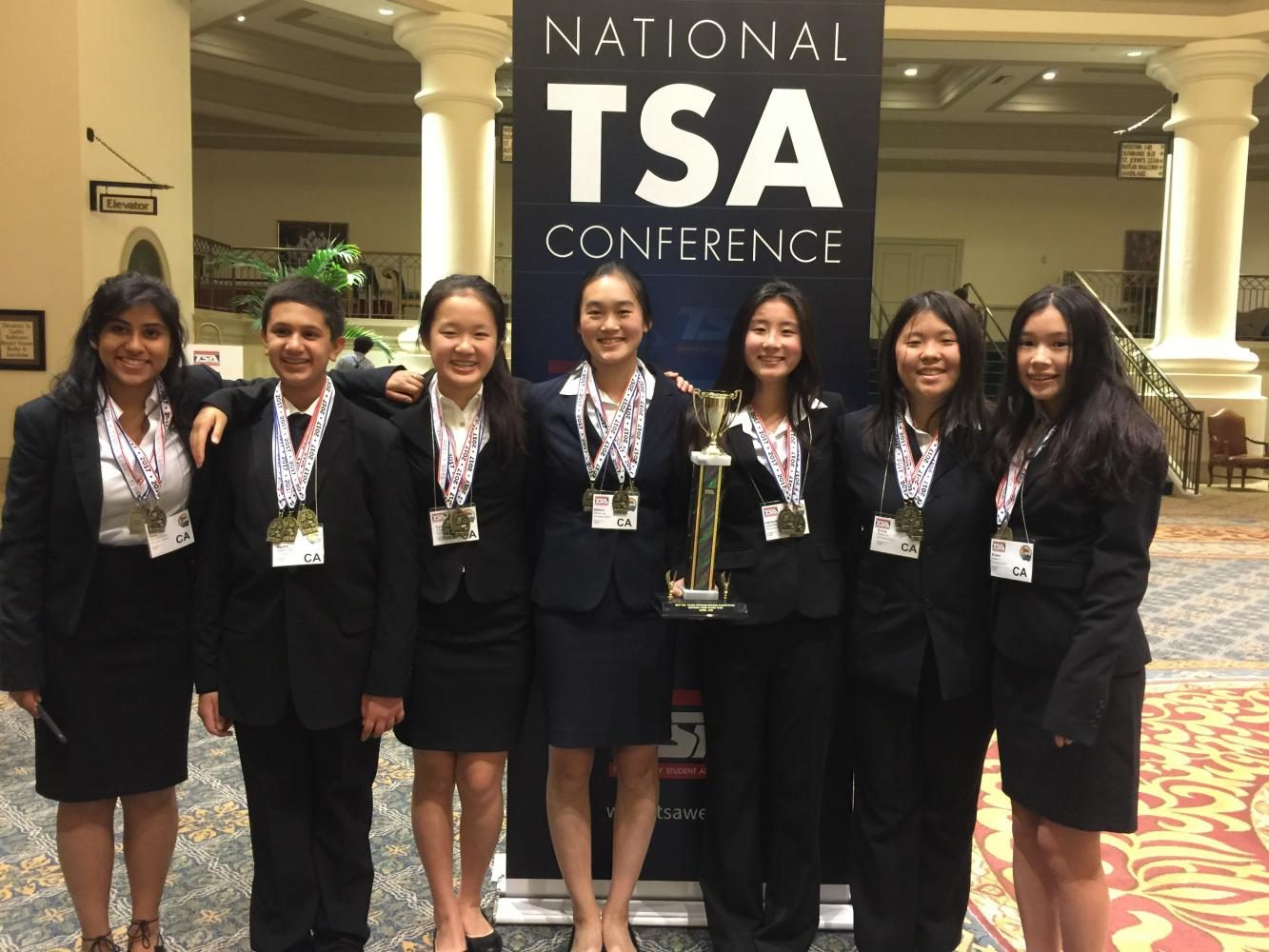 Sophomores+Vani+Mohindra%2C+Sachin+Shah%2C+Cynthia+Chen%2C+Allison+Jia%2C+Jacqueline+%22Jackie%22+Yang%2C+Emily+Liu+and+Eileen+Li+pose+with+their+trophy.
