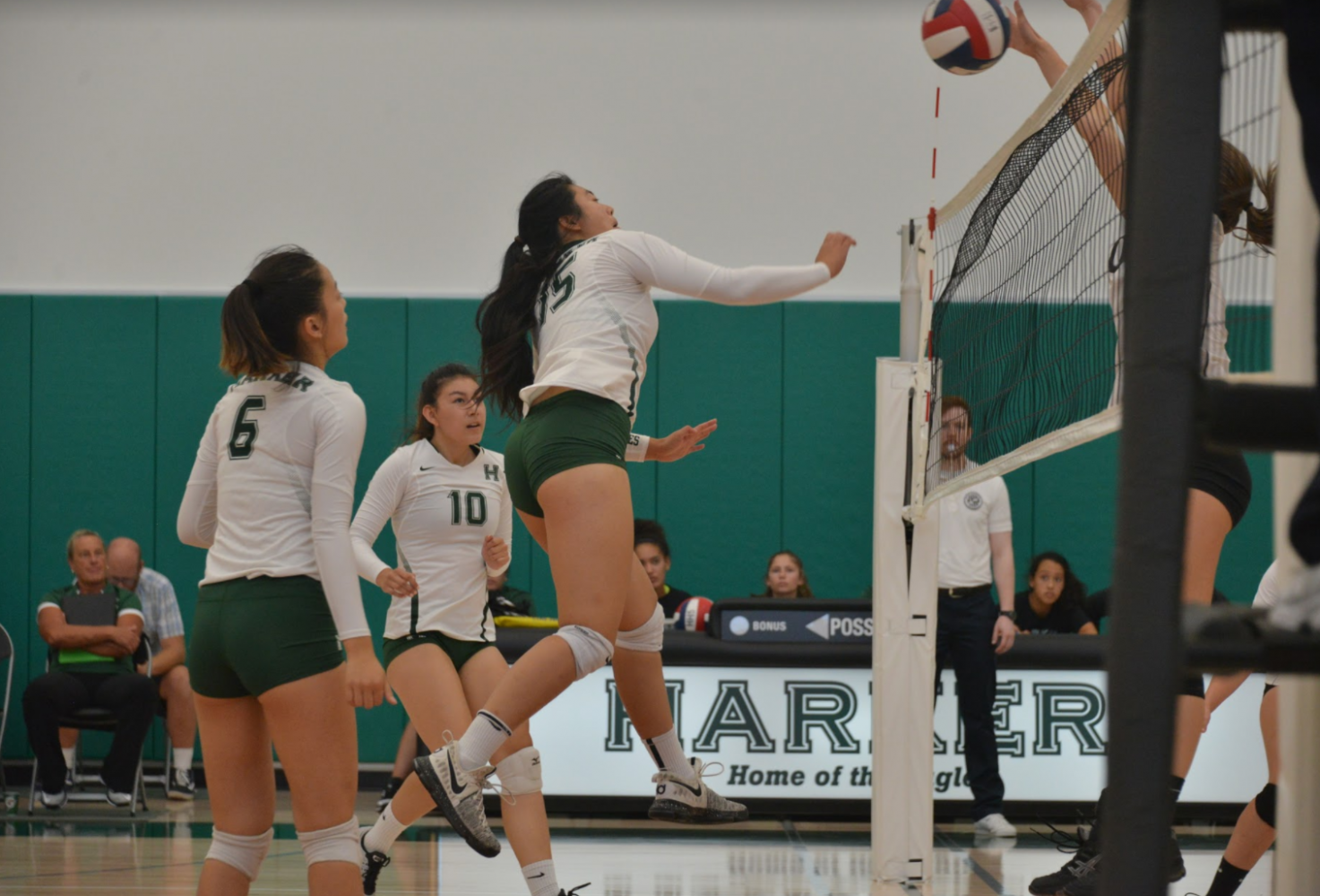 Tiffany Shou (12) jumps to hit the ball during the volleyball game against Westmont High School. The girls went on to win the game in three sets.