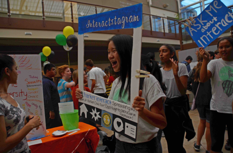 Gloria Guo (12) promotes Interact at last year's Club Fair. This year's Club Fair will be held during long lunch next Wednesday.